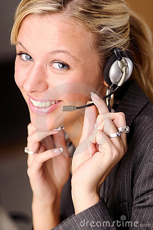 Attractive blonde businesswoman with headphone