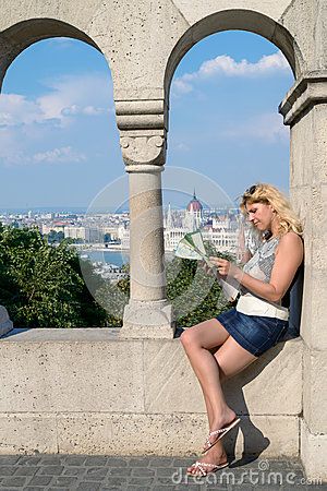 Free Attractive Blonde Female Traveller With Tourist Map In Centrall Stock Photo - 55621160