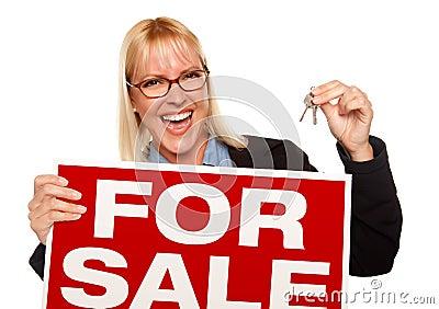 Attractive Blonde Holding Keys & For Sale Sign
