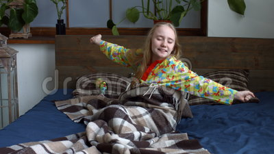 Cute little girl stretching her arms after awake stock video footage