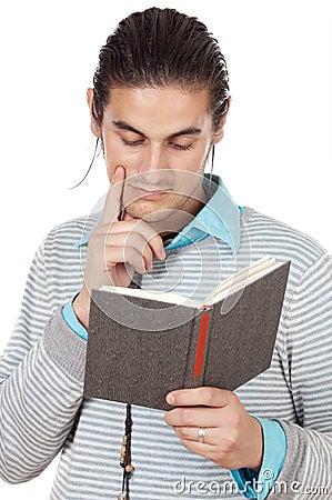 Attractive boy reading a book