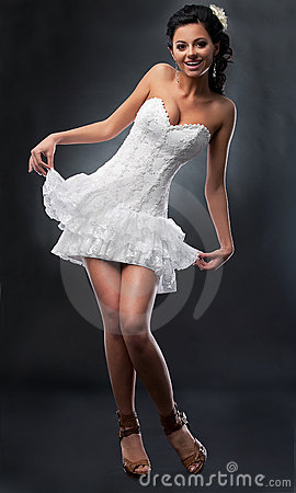 Attractive bride in bridal short dress.