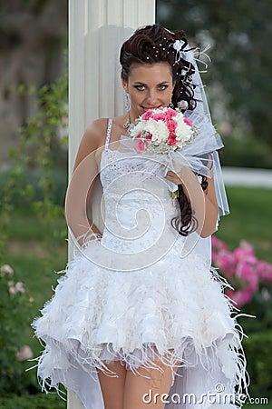 Attractive bride in the park