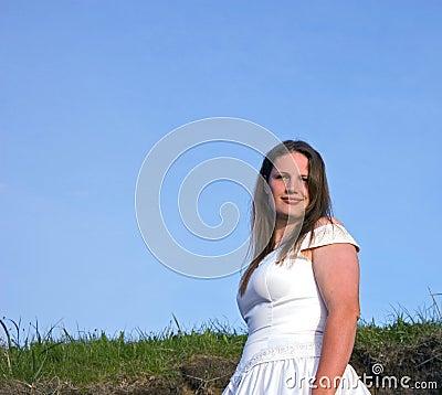 Attractive Brunette Bride Against Blue Sky