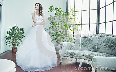 Attractive brunette bride thinking about future