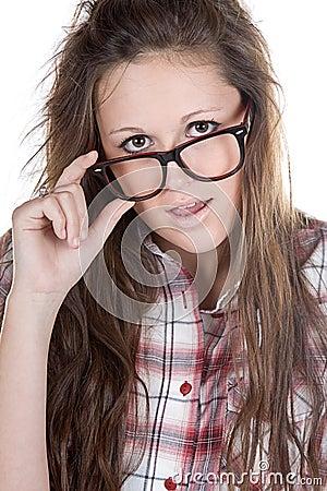 Attractive Brunette Geek Holding her Glasses