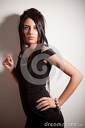 Attractive brunette girl in fashion black dress