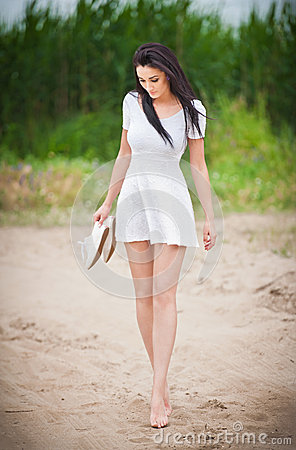 Free Attractive Brunette Girl With Short White Dress Strolling Barefoot On The Countryside Road. Young Beautiful Woman Walking Royalty Free Stock Photo - 45917275