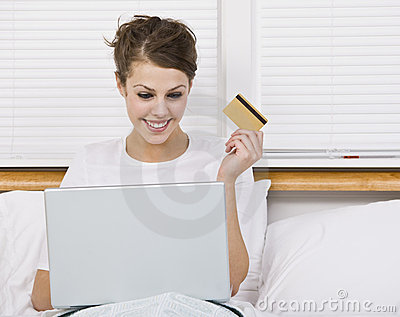 Attractive Brunette Holding Credit Card