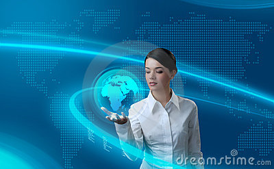 Attractive brunette holding virtual globe