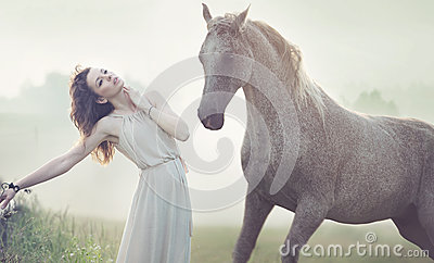 Attractive brunette lady and spotted horse