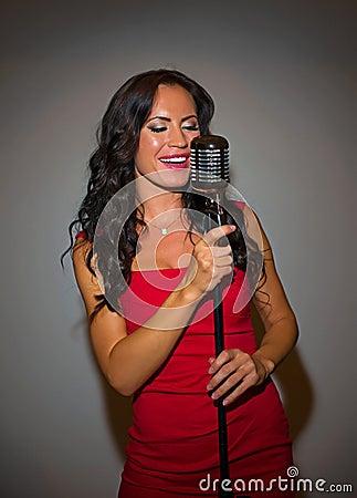 Attractive brunette woman singing.