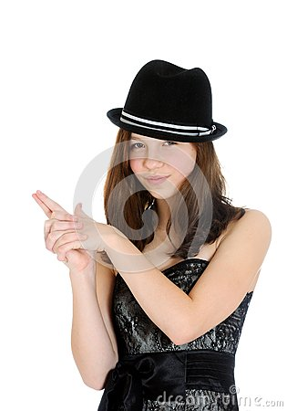 Attractive brunette young teenage girl with hand in shape of a gun