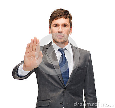 Attractive buisnessman making stop gesture