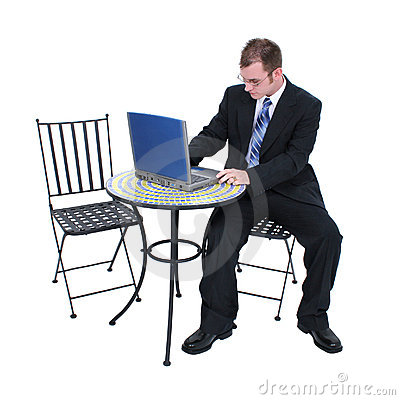 Attractive Business Man In Suit With Computer