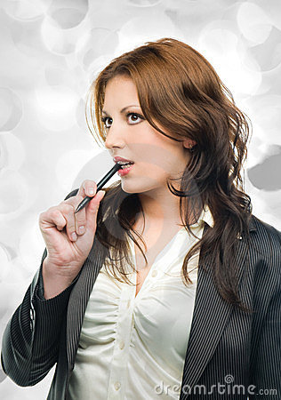 Attractive business woman dreaming