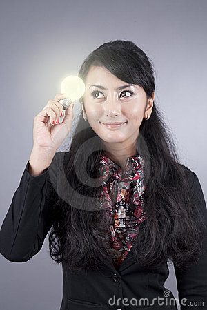 Attractive Business woman holding a light bulb