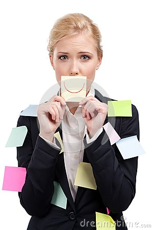 Attractive business woman holding a yellow sticker