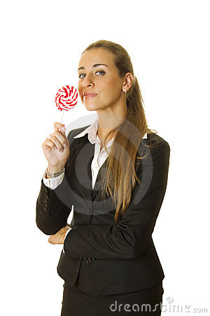 Attractive business woman with a lollipop