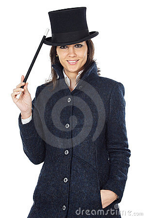 Attractive business woman with a magic wand and hat
