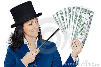 Attractive business woman with a magic wand and hat making appea