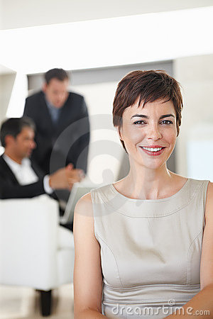 An attractive business woman smiling in the office