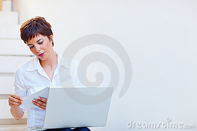 Attractive business woman using laptop