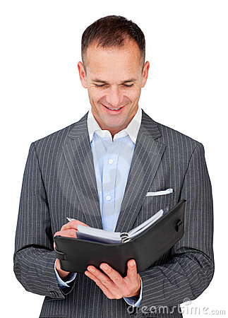 Attractive businessman consulting his agenda