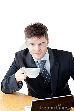 Attractive businessman holding a cup of coffee