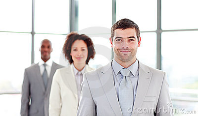 Attractive businessman leading his colleagues