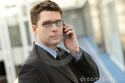 Attractive businessman with phone
