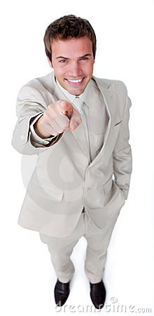 Attractive businessman pointing at the camera