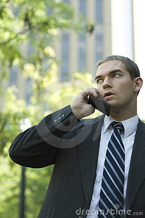Attractive Businessman Using Cell Phone Outside