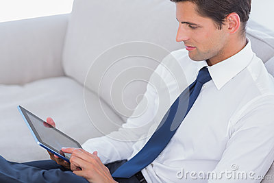 Attractive businessman using digital tablet