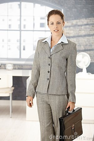 Attractive businesswoman arriving to bright office