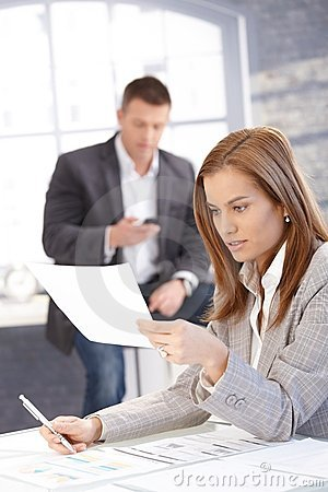 Attractive businesswoman busy by working