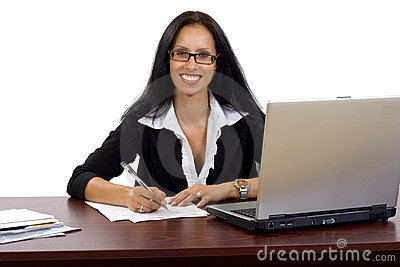 Attractive businesswoman at her desk