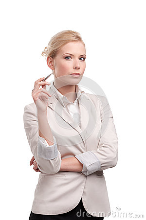 Attractive businesswoman in a light beige suit