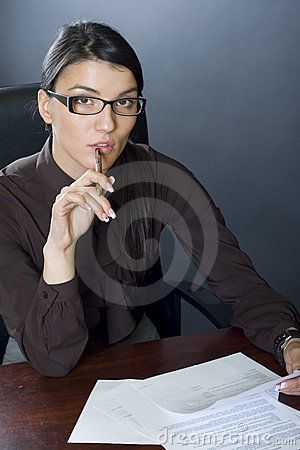 Attractive businesswoman with papers and pen