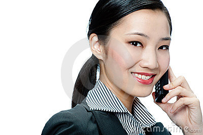 An attractive businesswoman with phone