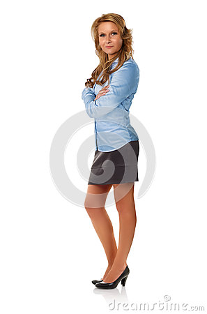 Attractive businesswoman posing with arms crossed