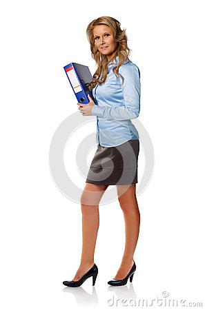 Attractive businesswoman posing with binder