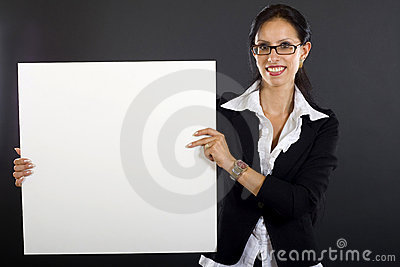 Attractive businesswoman presenting a blank board