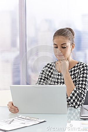 Attractive businesswoman using laptop computer