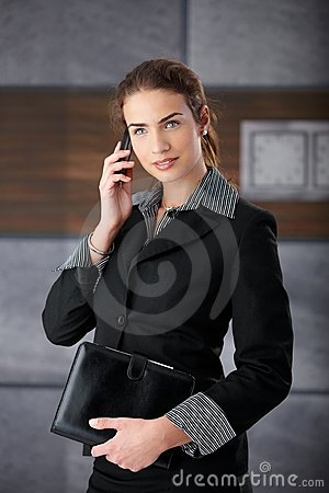Attractive businesswoman using mobile