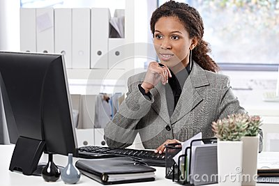 Attractive businesswoman working in office