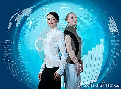 Attractive businesswomen in futuristic interface