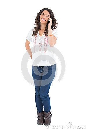 Attractive casual brunette having phone call