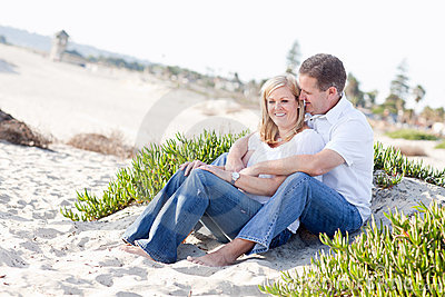 Attractive Caucasian Couple Relaxing at the Beach