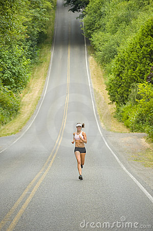 Attractive Caucasian Female Runner on Country Road